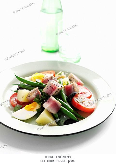 Plate of summer fruit salad with tuna