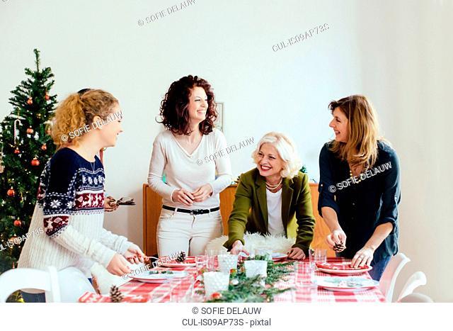 Women preparing for family Christmas party