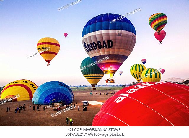 Hot air balloons taking off for a sunrise flight from the West Bank of the Nile in Egypt