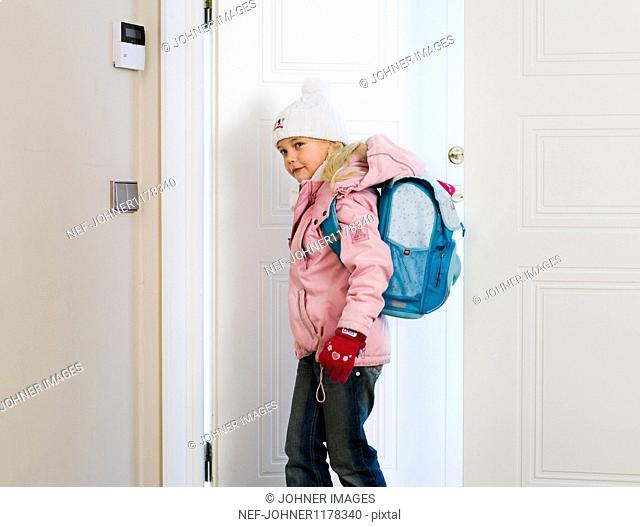 Girl entering house