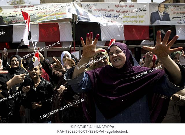 Egyptian women gesture on the first day of the 2018 Egyptian presidential elections at a polling station in Cairo, Egypt, 26 March 2018