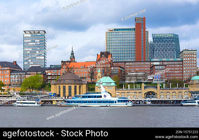 View of St. Pauli's Pier Landungsbrücken station tower with buildings and boats in Hamburg