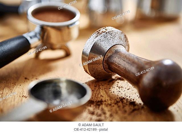 Close up coffee tamper and espresso
