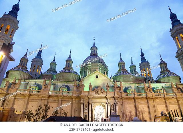 View of the basilica of Our Lady of Pilar, at sunset in Zaragoza Aragon Spain. Christmas time
