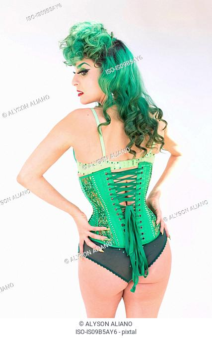 Rear view of woman with dyed green hair wearing corset