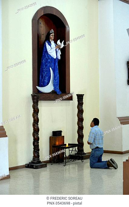 Man praying inside church, Coban, Guatemala, Central America
