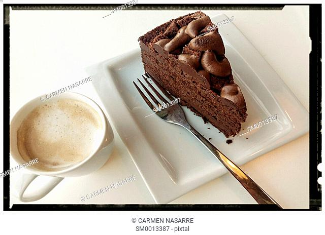Snack with coffee and chocolate cake with photo frame in black