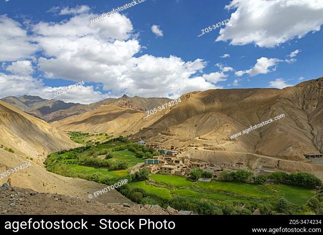 Village buildings and farming surrounded by mountains, Fotula Pass, Ladakh, India