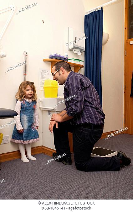GP Doctor surgery patient consultation  Child height measurement