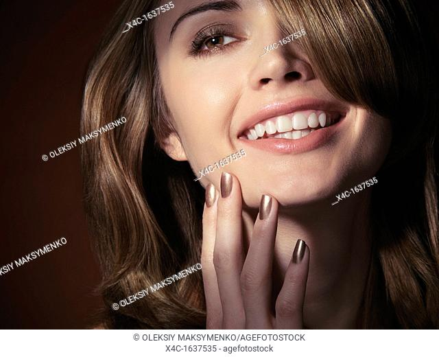 Close up emotional portrait of a smiling young beautiful woman