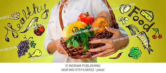 Vegetables in hands. Unrecognizable woman holding basket full of natural organic food. Sketches around her