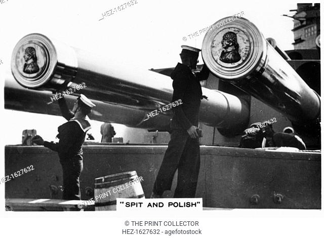 Sailors polishing the 16 inch guns of HMS 'Nelson', 1937. HMS 'Nelson' was a Nelson-class battleship of the Royal Navy built between the two World Wars