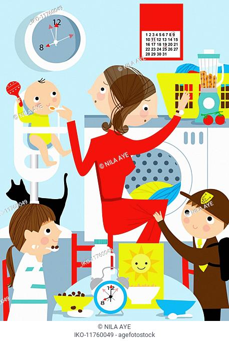 Mother busy multitasking with children in kitchen at breakfast time