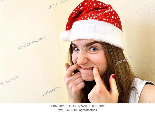 female santa portrait looking cute and funny indoors closeup