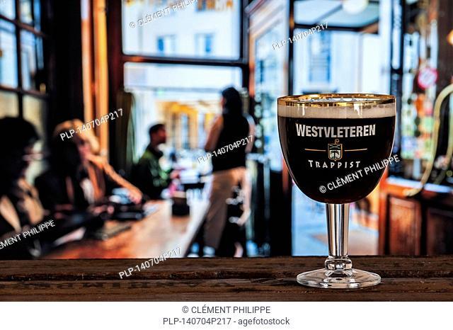 Glass with trappist Westvleteren - best beer in the world, brewed in the Sint-Sixtusabdij / Abbey of Saint Sixtus - served in café in Belgium