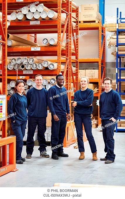 Portrait of factory work team in factory warehouse