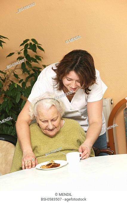 HOME FOR THE AGED Photo essay in a nursing home for the elderly in the department of Aisne, France. Nurse's aide with a retired woman having her afternoon tea