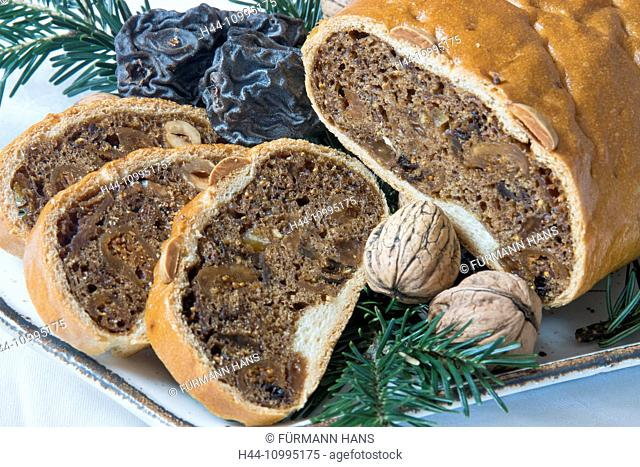Kletzenbrot - a fruit loaf typical for Bavaria with dry fruits and nuts as a filling