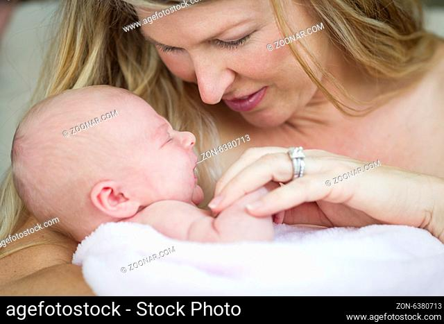 Young Caucasian Beautiful Mother Holding Her Precious Newborn Baby Girl