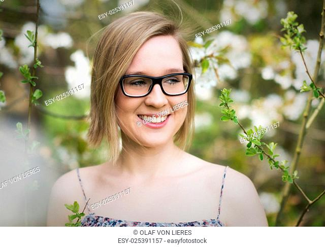young woman with glasses in the spring