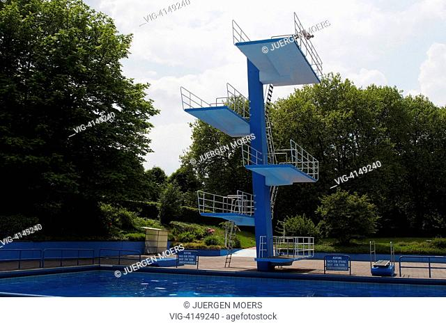 05.06.2013, Germany, Gladbeck, empty public swimming pool with pool tower. - 05/06/2013