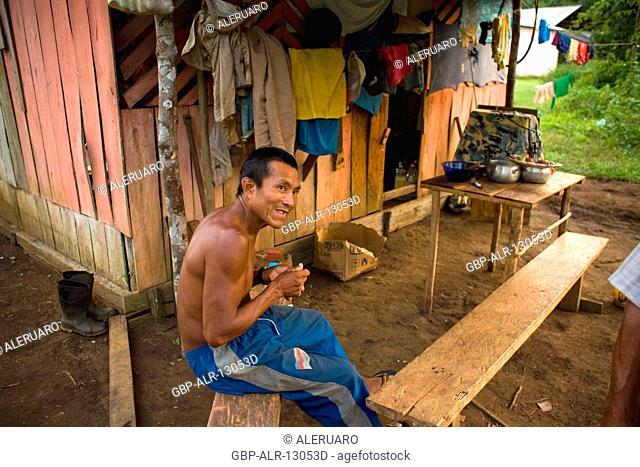 Houses, Man, Terra Preta Community, Cuieiras River, Amazônia, Manaus, Amazonas, Brazil