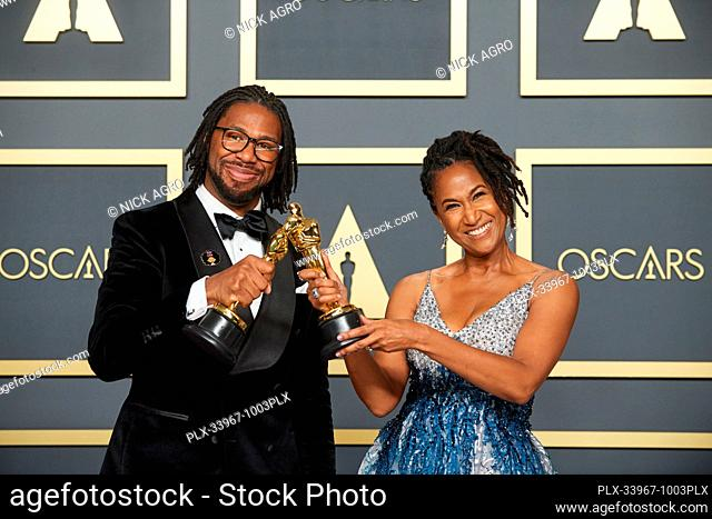 Karen Rupert Toliver and Matthew A. Cherry pose backstage with the Oscar® for Animated Short Film during the live ABC Telecast of The 92nd Oscars® at the Dolby®...