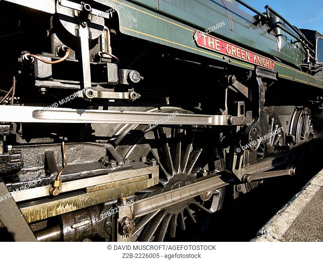 Detail of the wheels of the Green Knight vintage steam locomotive on the North Yorkshire Moors Railway, near Whitby, North Yorkshire, UK