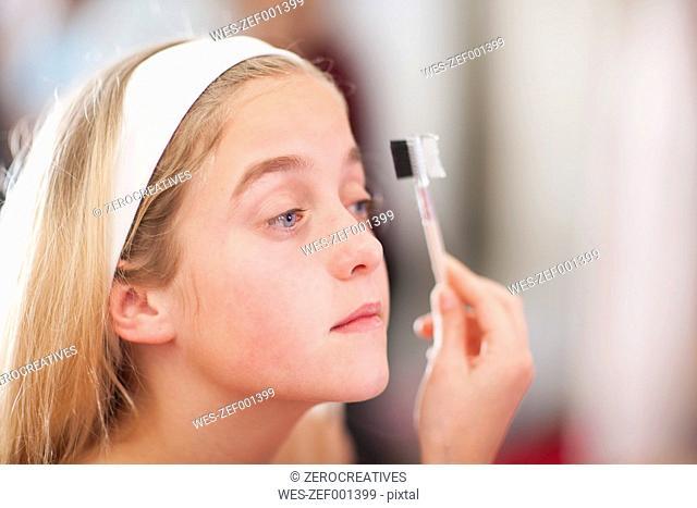 Girl on a beauty farm applying make-up