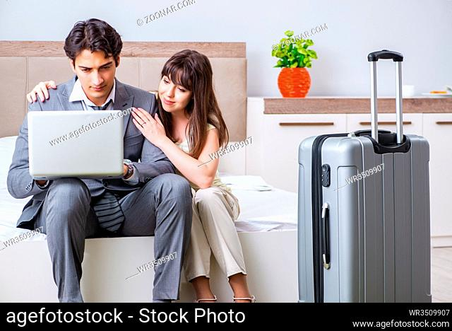 Wife seeing her husband off to business trip
