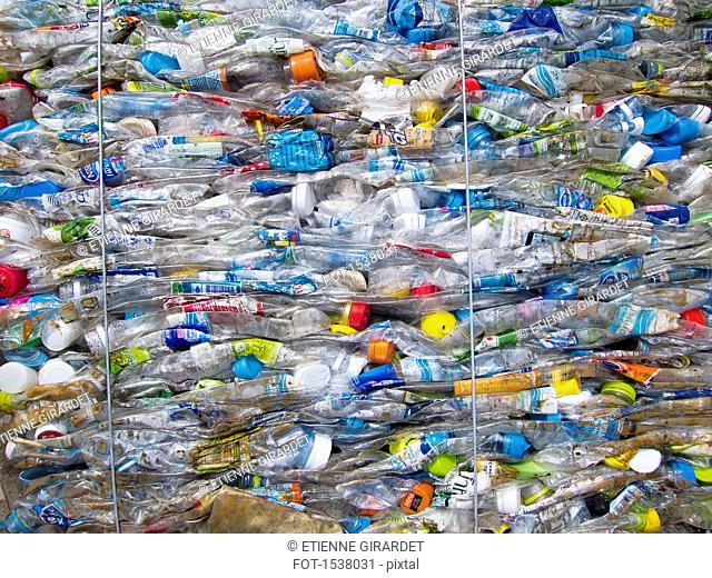 Full frame shot of crushed plastic bottles at garbage dump