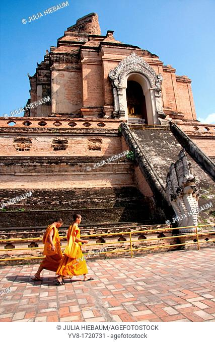 Two monks walking in front of Wat Chedi Luang, Chiang Mai, Thailand