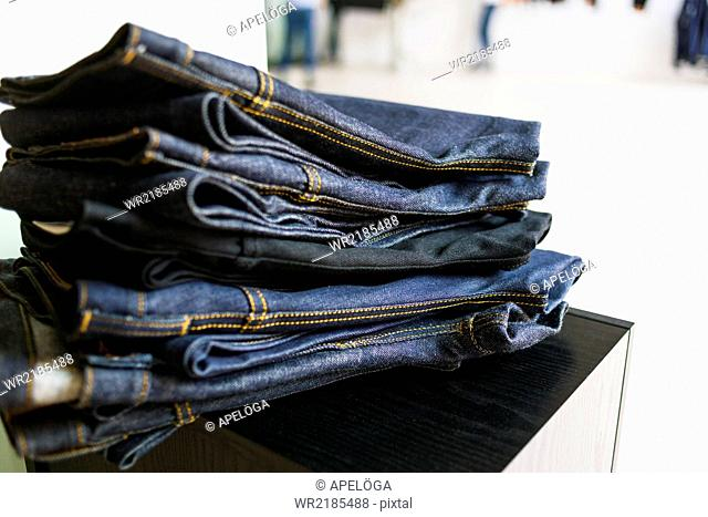 Stack of new jeans in factory
