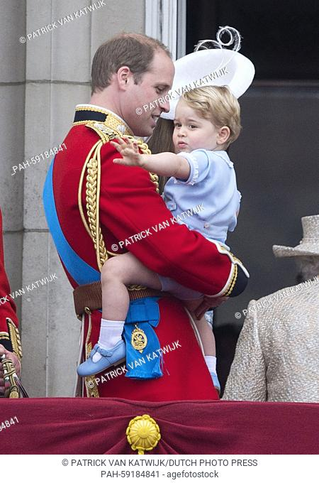 Prince William (L), the Duke of Cambridge, and his son Prince George on the balcony of Buckingham Palace, central London 13 June 2015 following the Trooping the...