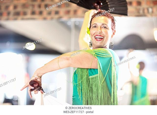 Smiling female senior latin dancer