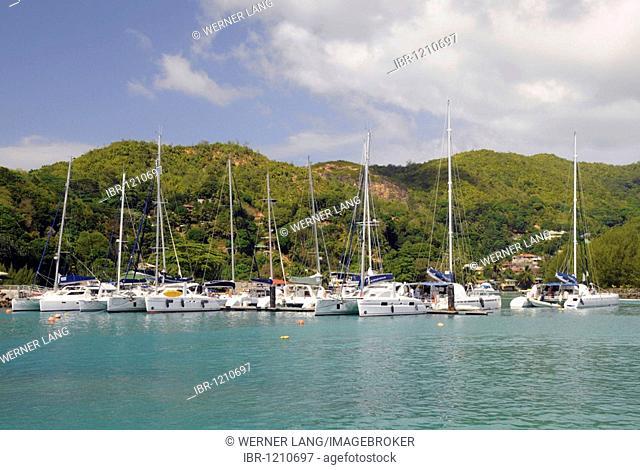 Sailing yachts in the harbour of Baie Ste. Anne, Praslin Island, Seychelles, Africa, Indian Ocean