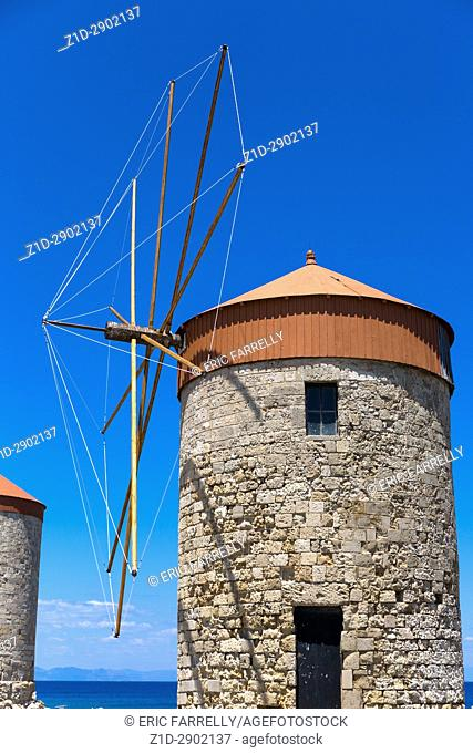 Old windmills at Rhodes harbour Greece
