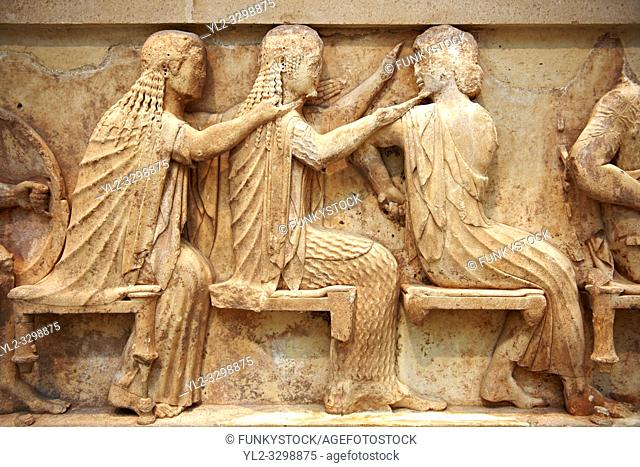 Treasury of Siphnos East Frieze representing scenes from the Trojan War. 525 b. C. . From Left: Aris, Afrodite, Artemis. Delphi Archaeological Museum