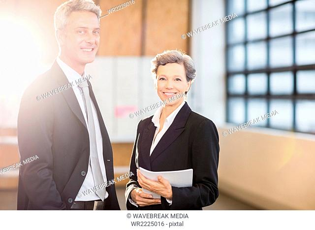 Business team smiling at camera together
