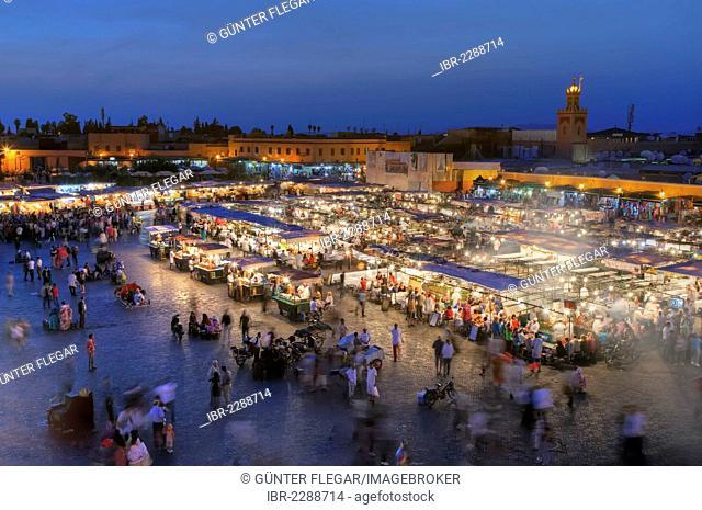 Hustle and bustle at the Djemaa el Fna or Jemaa el-Fnaa square, UNESCO World Heritage Site, Marrakech, Marrakech-Tensift-El Haouz, Morocco, Mahgreb