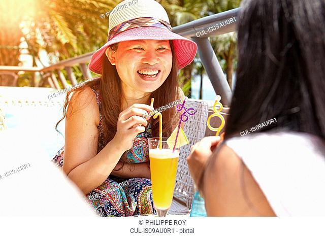 Mid adult woman and daughter at beach cafe, Zhuhai, Guangdong, China