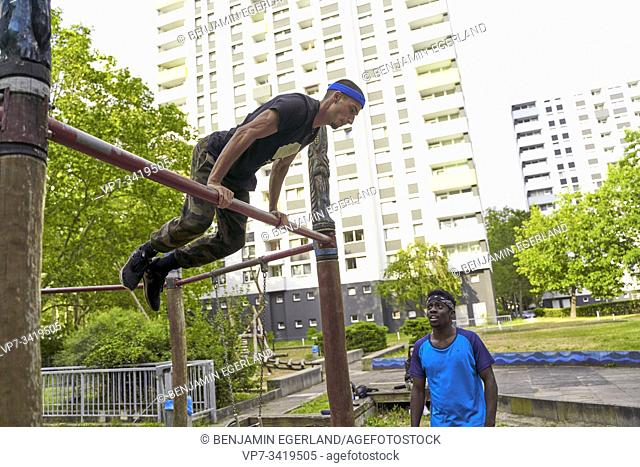 Young man doing acrobatics in park. Frankfurt am Main, Germany