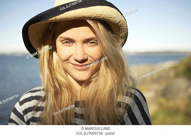 Portrait of young woman straw sun hat