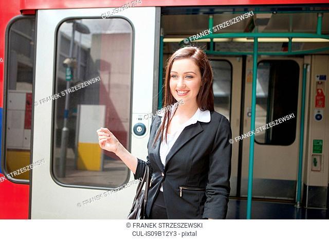 Businesswoman in Docklands Light Railway train, London