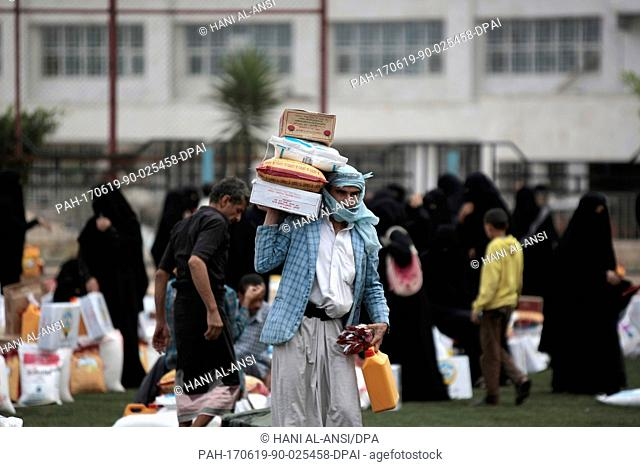 A Yemenite man carries an aid donation by the government of Kuwait in Sanaa, Yemen, 19 June 2017. Unabated conflict and rapidly deteriorating conditions across...