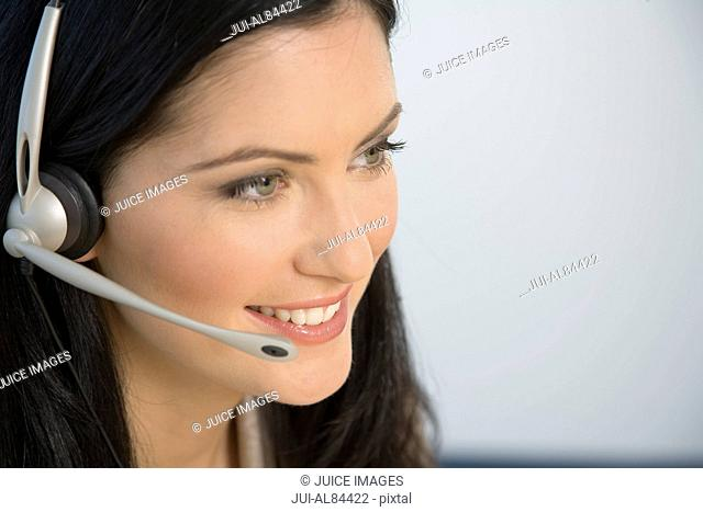 Businesswoman smiling with headset