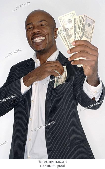 Coloured man presenting dollar bills