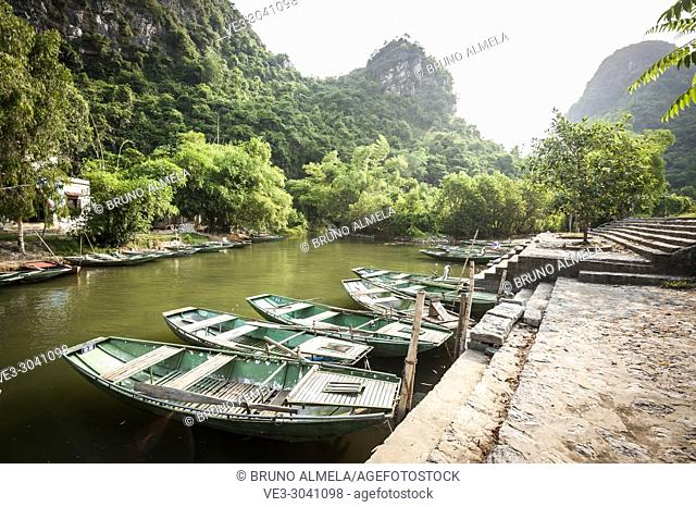 Boats in a river of Trang An karst Landscape Complex (Ninh Binh province, Vietnam)