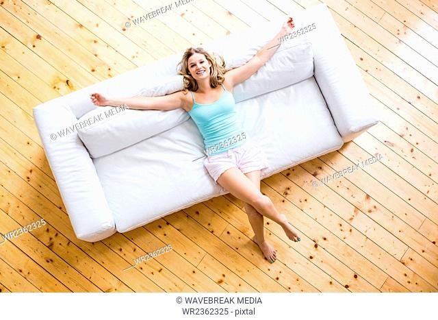 Young woman relaxing on sofa