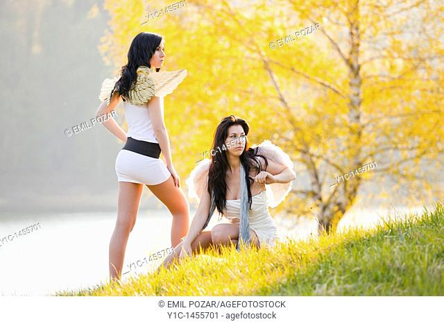 Attractive young women, acting nature angels